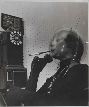 Martian Woman on the Telephone (circa 1955) by Weegee.jpg